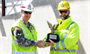 Tulsa District Commander Col. Michael Teague presents the 2012 Eagle Eye Construction Safety Program Award for Contractor of the Year to David Mattson, project manager for the Kiewit Building Group.